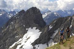 Germany, Bavaria, Karwendel, Couple mountain biking Stock Photos
