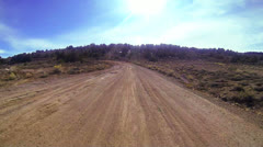 POV shot driving along a dirt road. Stock Footage