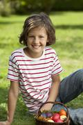 Germany, Girl (8-9 Years) smiling with easter egg, portrait Stock Photos
