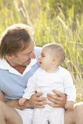 Germany, Bavaria, Father playing with (2-5 months) baby girl - stock photo