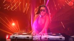 Glamorous sexy busty DJ Stock Footage