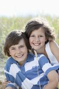 Germany, Bavaria, Boy (10-11 Years) and girl (8-9 Years) playing, smiling Stock Photos