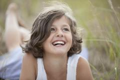 Stock Photo of Germany, Bavaria, Girl (8-9 Years) looking up, smiling