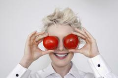 Crazy blonde with two red apples Stock Photos