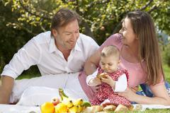 Germany, Bavaria, Family having picnic - stock photo
