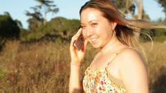 Young Asian Woman Talking on Cell Phone in Field Stock Footage