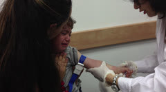 Young boy having a blood test Stock Footage