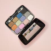 Eye shadow compact and applicator, elevated view - stock photo