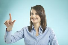 Businesswoman gesturing, smiling Stock Photos