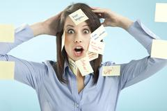 Stock Photo of Businesswoman with adhesive notes on her face
