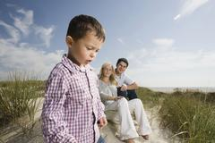 Germany, Schleswig Holstein, Amrum, Family in sand dunes Stock Photos