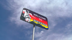 A sign welcomes visitors to Nevada. Stock Footage
