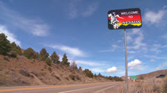 A sign welcomes visitors to Nevada. - stock footage