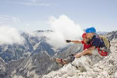 Stock Photo of Germany, Garmisch-Partenkirchen, Alpspitz, Mountaineers, Boys (10-11), (12-13)