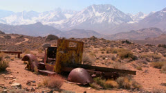 Abandoned pickup truck with the snowcapped Sierra Nevada mountains with the sun - stock footage