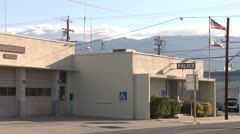 An establishing shot of a police station in an American town. Stock Footage