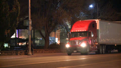 An unmarked double tractor trailer truck drives through the night. Stock Footage