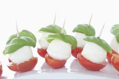 Mozarella with Basil on white background, close up Stock Photos