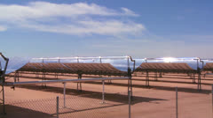 Pan across a solar farm in the desert generates electricity. Stock Footage