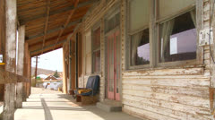 The facade of an old bar or diner sits in the Mojave desert. Stock Footage