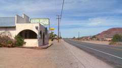 An old bar or diner sits in the Mojave desert. Stock Footage