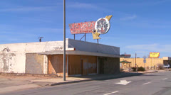 An abandoned liquor store sits in a modern ghost town near Boron, California. Stock Footage