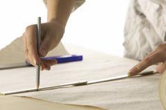 Woman assigns wallpaper Stock Photos