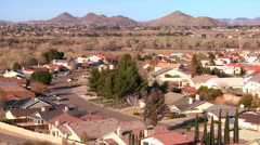 Stock Video Footage of Birds eye view over neighborhoods and suburban sprawl in a desert community.