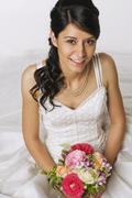 Young bride holding flowers, elevated view - stock photo