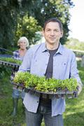 Germany, Saxony, Man and woman at the farm, smiling, portrait - stock photo