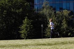 Stock Photo of Germany, Berlin, Young man jogging, side view