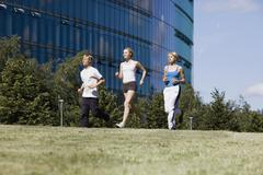 Germany, Berlin, Three persons jogging Stock Photos