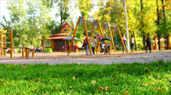 Playground in park, children play, run, have fun. - stock footage