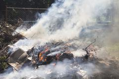 Burning garbage dump Stock Photos