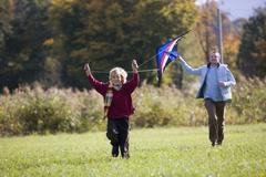Father and son flying kite Stock Photos