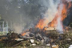 burning garbage dump - stock photo