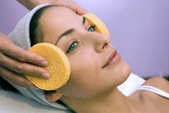 woman receiving face treatment - stock photo