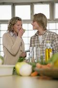 mother and son in kitchen - stock photo