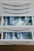Medical practice, drawer with sterile plastic packings - stock photo