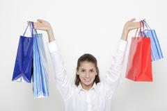 Young woman (16-17) with shopping bags - stock photo