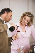 couple, man pouring wine in glass - stock photo