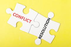 Conflict and resolution words Stock Photos