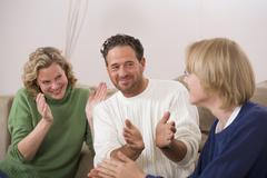 Parents applauding to son Stock Photos