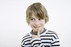 Boy (10-11), finger to chin, portrait - stock photo
