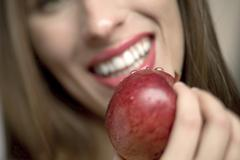 Young woman holding  apple, close-up - stock photo