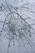 Broken window pane, close up - stock photo