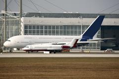 Aeroplanes on runway Stock Photos