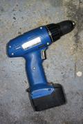Germany, Hessen, Frankfurt, Cordless screwdriver in factory - stock photo