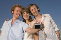 Stock Photo of Germany, Bavaria, Three friends taking self portrait