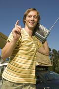 Germany, Bavaria,  Young man carrying a transistor Radio on his shoulder - stock photo